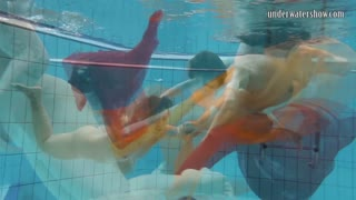 Two hotties submerged underwater